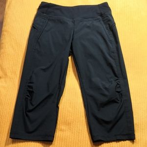 Lululemon black wide leg capris with pocke…